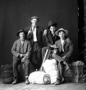 Friends posing for a funny photo with props, or a remorseless group of train robbers, laughing about their latest haul?